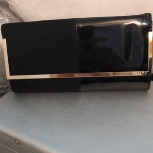 Black suede and patent leather clutch bag